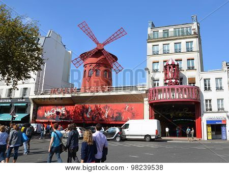 PARIS, FRANCE - SEPTEMBER 10, 2014: The Moulin Rouge in Paris France. Moulin Rouge is the most famous Parisian cabaret and it created the modern can-can dance.