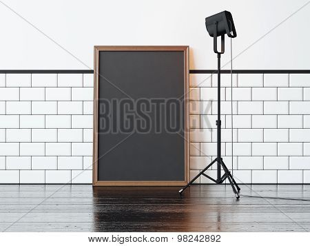 Black poster and lamp, white wall. 3d rendering