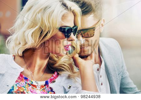 Happy fashionable couple in the city
