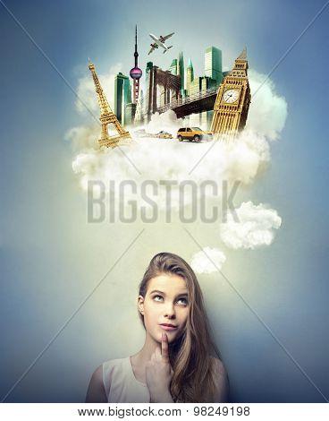 Blonde girl dreaming of travelling far away
