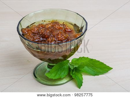 Mulberry jam in the bowl with mint leaves poster