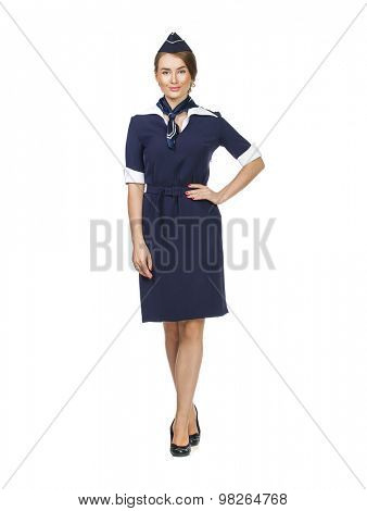 Front side, full body of a beautiful dark haired young business woman dressed in a dark blue suit with a blue scarf smiling, isolated on white background