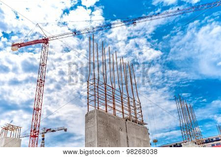 Construction Site With Industrial Crane And Close Up Of Reinforced Concrete Walls