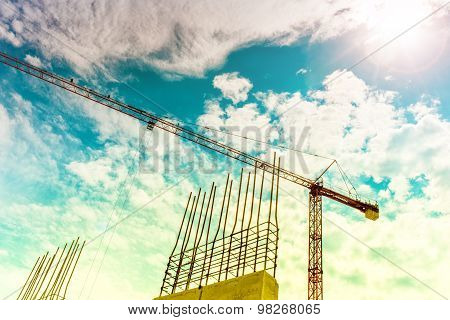 Industrial Construction Crane Building Skyscrapers And Houses. Crane Silhouette On Construction Site