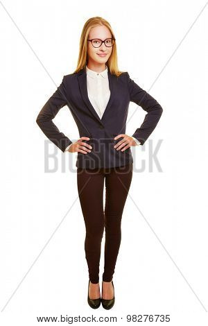 Front view of young business woman with her arms akimbo