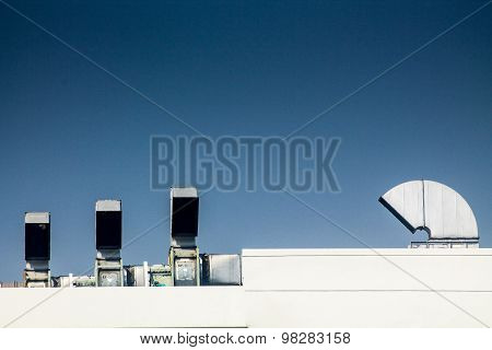Industrial air conditioning and ventilation systems on  roof factory.