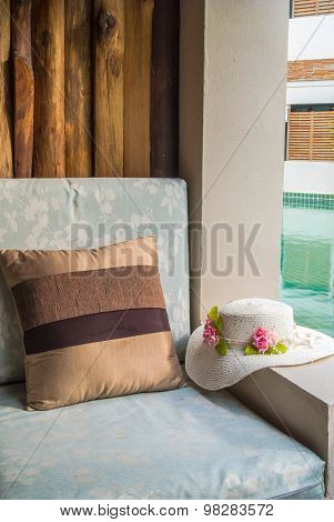 Cushion And Hat At Balcony Poolside.