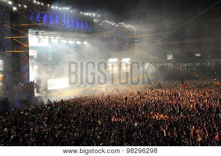 Crowd Of People In A Stadium At A Concert