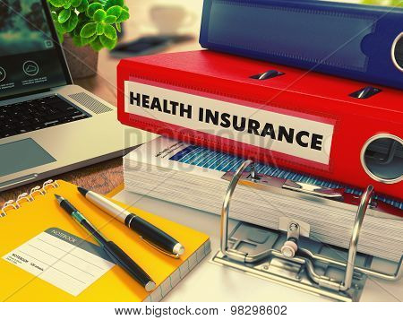 Red Office Folder with Inscription Health Insurance.