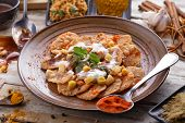 full portrait of indian streetfood papri chaat garnished and served with yoghurt poster