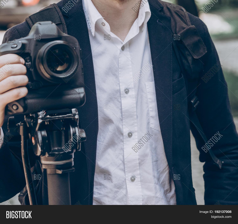 Stylish Man Holding Photo Camera. Professional Holding Video Camera At  Wedding Ceremony Photographer Or Videohgrapher