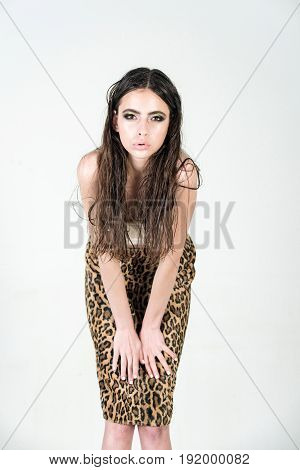 Fashion Woman In Skirt Has Long Hair And Fashionable Makeup