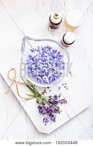 ingredients for lavender spa flower and salt on white wooden background.