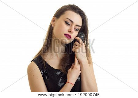 close up portrait of young brunette woman with microphone in hands isolated on white background