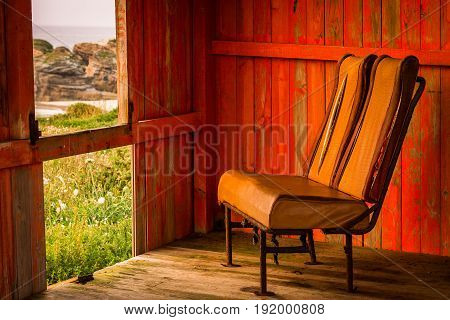 Old chair in a shed to enjoy the coastal views