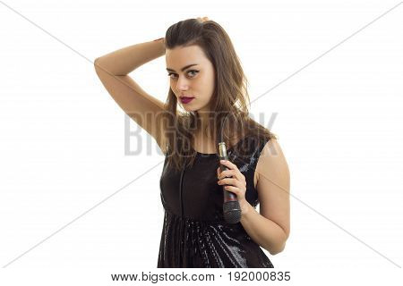 cutie young woman with microphone in her hands looking at the camera isolated on white background
