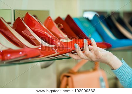 Shopping Showcase With Female Footwear And Hand