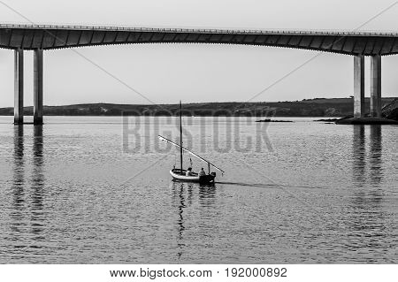 Two women sailing in a bay in Northern Spain