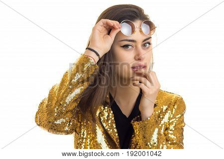 young brunette woman in golden jacket looking at the camera isolated on white background