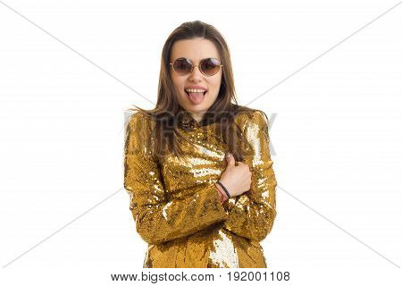 funny young woman in sunglasses and golden jacket screaming on camera isolated on white background