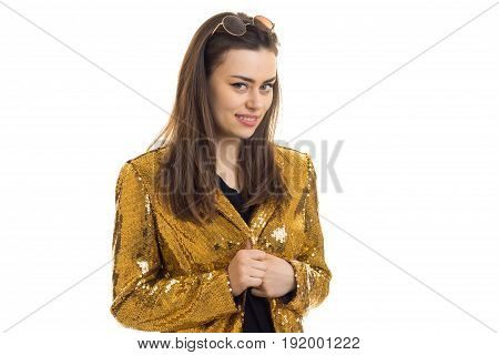 Cheerful girl in golden jacket smiling on camera isolated on white background