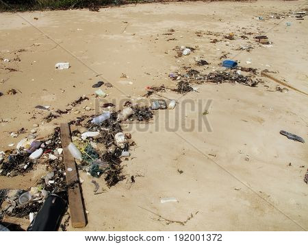 close up trash and pollution on sandy beach