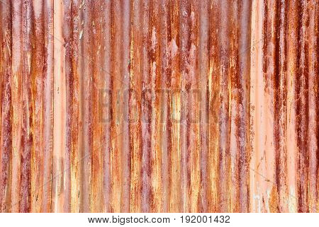 Old steel surface with red peeling paint