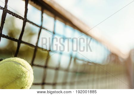 Ball in net closeup, big tennis concept