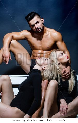Sexy Twin Girls And Man With Muscular Body