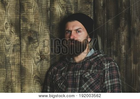 Bearded Man Posing In Stylish Black Hat And Plaid Jacket