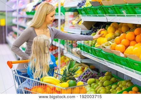 Market supermarket girl little mother shopping consumerism