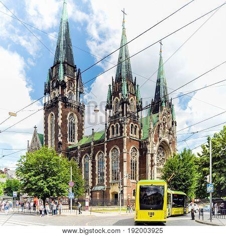 Lviv, Ukraine - June 19, 2017: The Church of Sts. Olha and Elizabeth on Kropivnitsky Square. Street scene.