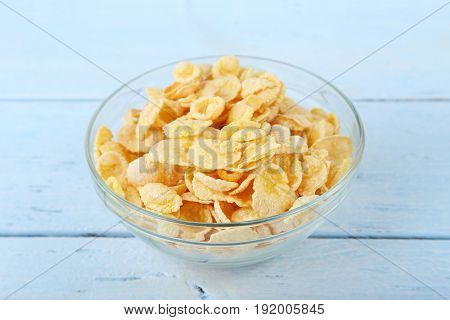 Cornflakes In Bowl On Blue Wooden Table