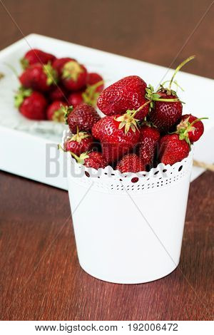 fresh Strawberry in a bowl.Ripe strawberries on a wooden background.