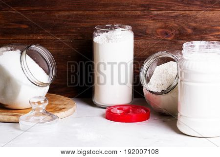 Bakery ingredients. Sweet pastry baking concept. Arrangement of dry food products and kitchen utensils in the kitchen. Home kitchen rustic still life.flour and other kitchen utensils. The concept of simple healthy home cooking.