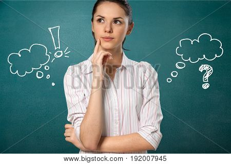 Young woman thoughtful exclamation mark question mark speech bubbles green