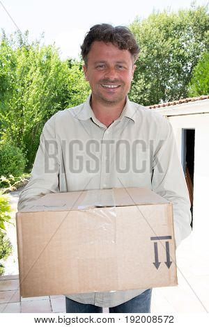 Worker Man Delivery Parcel At Home House With Smile