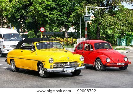 Mercury Eight And Volkswagen Beetle