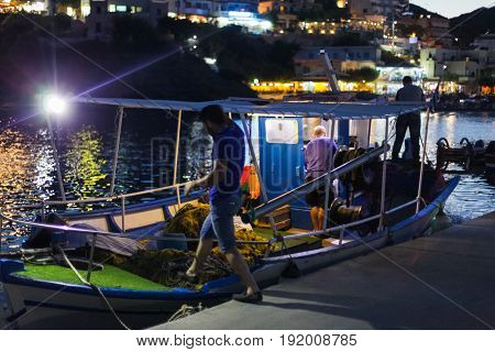 Bali Island Crete Greece - June 30 2016: Greek fishermen are leaving for night catching fish on the fishing boat from the small port located on Crete island in Greece.