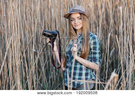 Attractive Young Blonde Woman In Blue Plaid Shirt Straw Hat Enjoying Her Time Taking Photos On Wild