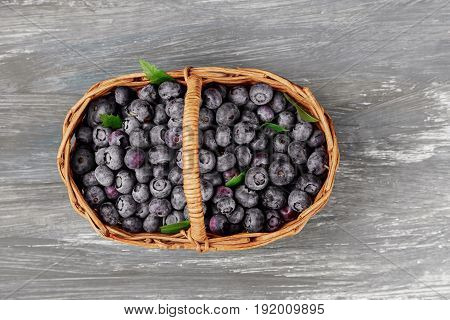 Fresh Blueberries In Basket Old Table, Ripe Fruits From Forest On Farmer Market, Overhead
