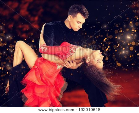 Man woman dancing salsa fun red entertainment