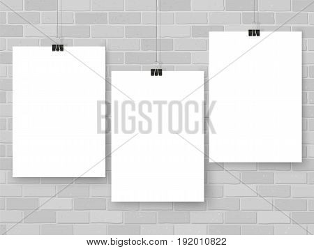Posters on binder clips on brick wall. Paper mockups set. Modern trendy framing for your design. Vector template for picture painting drawing quotes poster or photo.