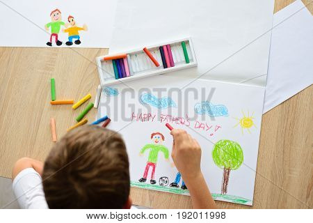 Child Drawing A Card For Daddy