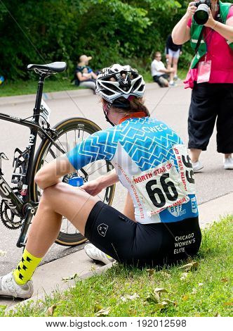 STILLWATER, MINNESOTA/USA - JUNE 18, 2017: Lily Williams wins the Women's Best Amateur classification of the North Star Grand Prix and rests after completing the final stage of the pro cycling race.