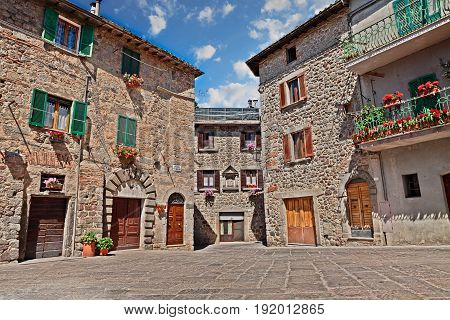 Abbadia San Salvatore, Siena, Tuscany, Italy: view of the ancient Piazza del mercato (market Square) in the medieval village