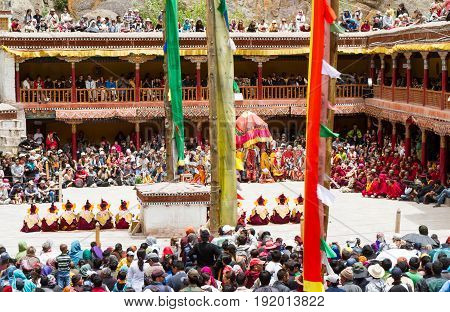 Hemis India -€ June 29, 2012: courtyard of the monastery during the Cham Dance Festival of Tibetan buddhism full of spectators and performers in Hemis monastery India.