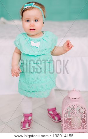 Adorable Little Baby Girl Laughing, Smiling, Creeping & Playing In The Studio Wearing Mint Dress