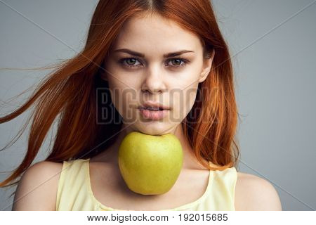 Diet, woman with apple, proper nutrition, apple, woman on gray background portrait.