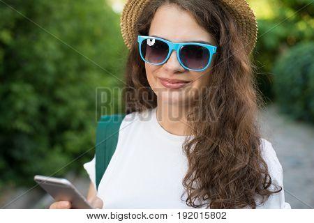 Girl Traveler Using Smartphone On Street